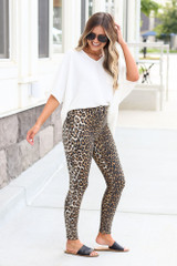 Model wearing the High-Rise Leopard Skinny Jeans with black bodysuit Side View