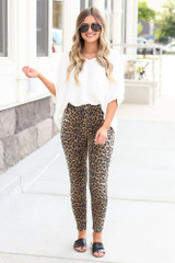 Model wearing the High-Rise Leopard Skinny Jeans with black bodysuit and heels from Dress Up