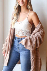 Model wearing the Crochet Bralette in Ivory with lightweight knit cardigan and high rise skinny jeans