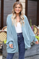 Sage - Model wearing the Oversized Knit Cardigan with a white tank