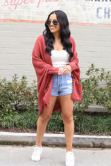 Model wearing the Oversized Knit Cardigan with a white tank and denim shorts