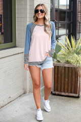 Model wearing the Color Block Top with denim shorts and white sneakers