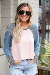 Dress Up model wearing the Color Block Top tucked into denim shorts