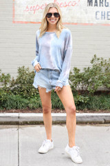 Dress Up model wearing the Tie-Dye Lightweight Oversized Pullover with denim shorts and white sneakers