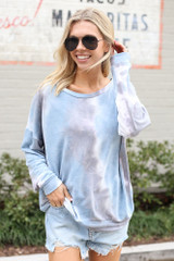 Model wearing the Tie-Dye Lightweight Oversized Pullover with denim shorts