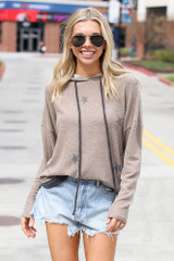 Dress Up model wearing the Star Brushed Knit Oversized Hoodie with denim shorts