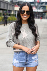 Dress Up model wearing the Star Lightweight Knit Top with denim shorts