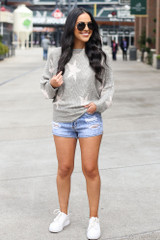 Model wearing the Star Lightweight Knit Top with denim shorts and white sneakers