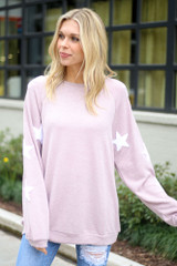 Model wearing the Star Sleeve Oversized Pullover in Blush