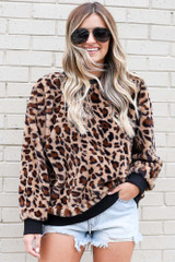 Model wearing the Leopard Faux Fur Pullover with high rise shorts