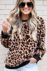 Model wearing the Leopard Faux Fur Pullover with high rise shorts Close Up