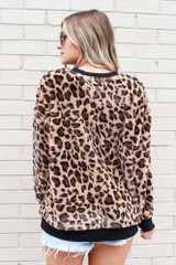 Model wearing the Leopard Faux Fur Pullover with high rise shorts Back View
