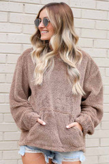 Dress Up model wearing the Fuzzy Knit Pullover Hoodie in Taupe