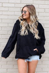 Dress Up model wearing the Fuzzy Knit Pullover Hoodie in Black with denim shorts