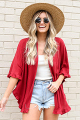 Model wearing the Burgundy Ruffle Trimmed Lightweight Knit Cardigan with straw wide brim hat