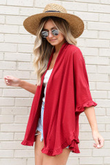 Model wearing the Burgundy Ruffle Trimmed Lightweight Knit Cardigan with white tank bodysuit from Dress Up