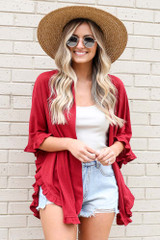Model wearing the Burgundy Ruffle Trimmed Lightweight Knit Cardigan with high rise denim shorts from online dress boutique
