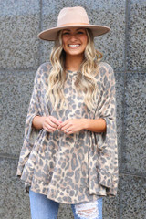 Model wearing the Leopard Print Fleece Poncho with a wide brim hat