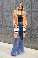 Dress Up model wearing the Striped Longline Cardigan with flare jeans