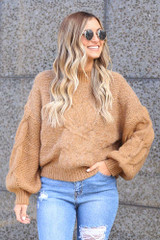 Model wearing the Mock Neck Cable Knit Top in Taupe Front View with distressed jeans