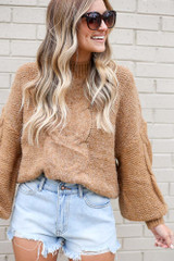 Model wearing the Mock Neck Cable Knit Top in Taupe with denim shorts
