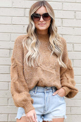 Model wearing the Mock Neck Cable Knit Top in Taupe with sunglasses from Dress Up