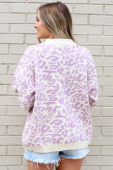 Model wearing the Leopard Luxe Knit Top in Purple with high rise shorts Back View
