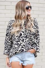 Model wearing the Leopard Luxe Knit Top in Black with high rise shorts