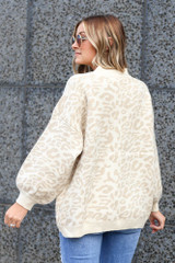 Model wearing the Leopard Luxe Knit Top in Taupe Back View