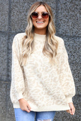 Model wearing the Leopard Luxe Knit Top in Taupe with high rise jeans