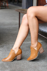 Model wearing the V-Cut Faux Leather Ankle Booties in Camel