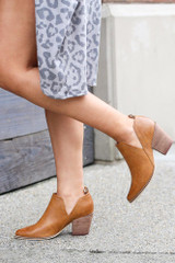 Dress Up model wearing the V-Cut Faux Leather Ankle Booties in Camel