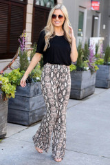 Dress Up model wearing the Snakeskin Stretch Knit Flare Pants with a black tee