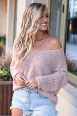 Model wearing the Lightweight Twist Back Sweater with denim shorts