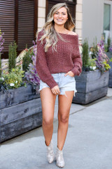 Model wearing the Cropped Eyelash Knit Top in Marsala with denim shorts and snakeskin booties