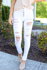 White - Close Up of the High-Rise Button Front Distressed White Jeans