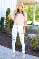 Dress Up model wearing the High-Rise Button Front Distressed White Jeans with nude mules