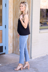 Model wearing Medium Wash High-Rise distressed Mom Jeans side view