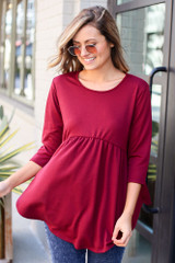 Model wearing the French Terry Babydoll Tunic from Dress Up in Burgundy Front View