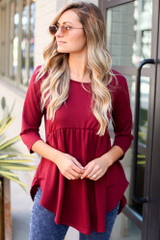 Model wearing the French Terry Babydoll Tunic with high rise jeans from Dress Up in Burgundy Front View