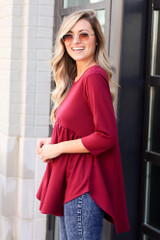 Model wearing the French Terry Babydoll Tunic from Dress Up in Burgundy Side View