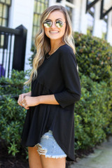 Model wearing the French Terry Babydoll Tunic from Dress Up in Black Side View