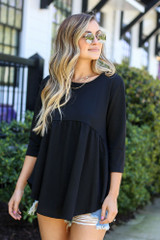 Black - Model wearing the French Terry Babydoll Tunic from Dress Up in Black Front View