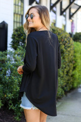 Model wearing the French Terry Babydoll Tunic from Dress Up in Black Back View
