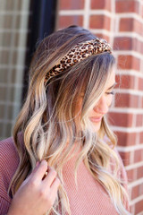 Model wearing the Leopard Print Knotted Headband from online dress boutique