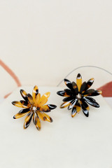 Flat Lay of the Tortoise Flower Stud Earrings from online dress boutique