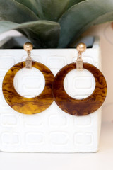 Flat Lay of the Acrylic Statement Earrings in Brown from Dress Up