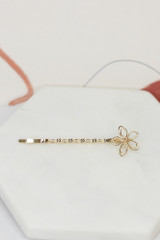 Flower bobby pin flat lay