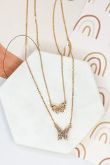 Flat Lay of the Rhinestone Butterfly Layered Necklace from online dress boutique