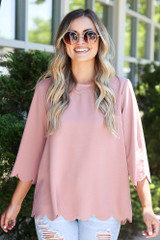 Model wearing the Scalloped Open Back Blouse in Blush